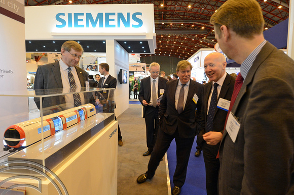 DG146732. Simon Burns MP at Siemens stand. Railtex 2013. London. 30.4.13.